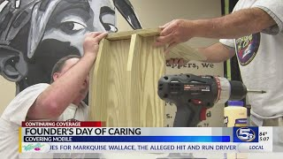 WKRG builds little libraries for Founder's Day of Caring