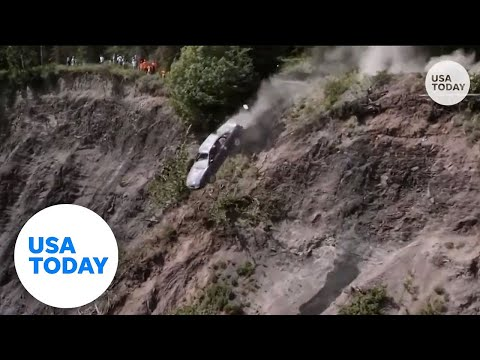 Cars launch off 300-foot cliff during Alaska town's annual tradition   USA TODAY