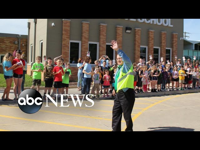 A man who worked as a crossing guard for a school for nearly 7 decades retires