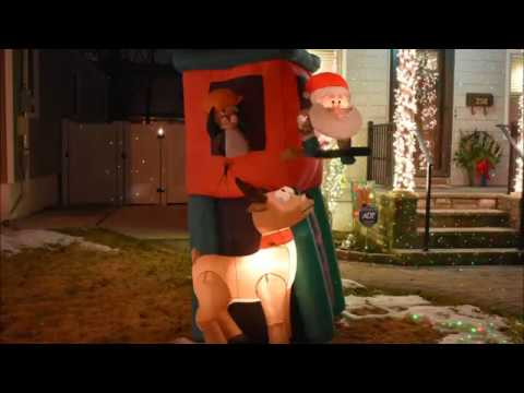 Santa in Deer Stand Hunting with Deer & Penguin Airblown Inflatable Christmas