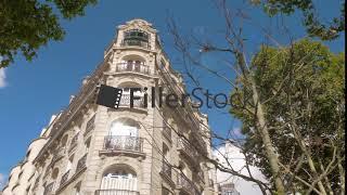Exterior of baroque style corner building in Paris, France