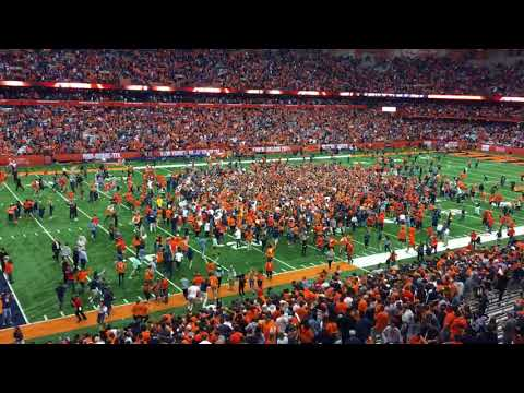 Syracuse fans fill the field after upsetting Clemson 27-24