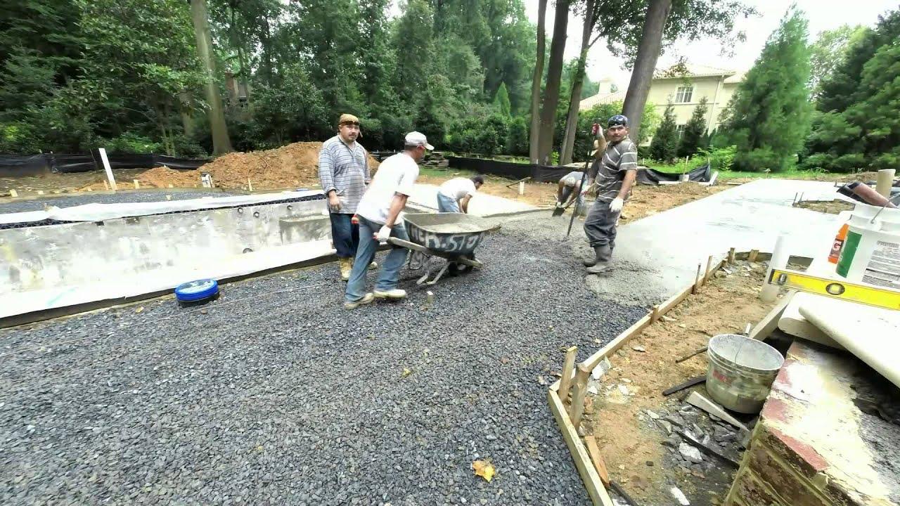 Concrete slab installation for Travertine pool deck. - YouTube