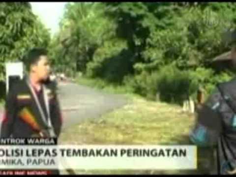 Police Break Up Tribal Dispute in Indonesia