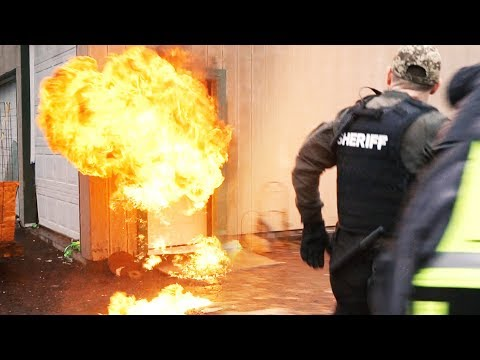 CRAZY SUSPECT ANSWERS THE DOOR WITH A FLAME THROWER!