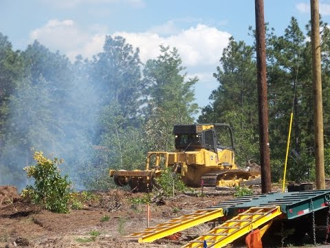 USFS John Deere 700K Fire Dozer helping to put out a brush fire.