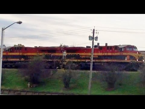 Pair of Kansas City Southern Engines Power Freight Train