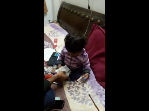 Baby enjoying music and playing with currencies in wallet