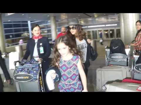 Salma Hayek And Daughter Arriving At The Los Angeles International Airport