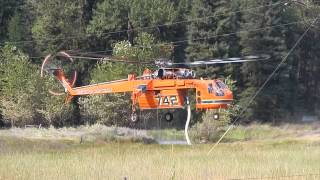Helicopter looking for water to fight fire