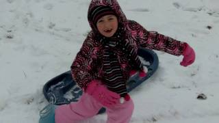 Carlee going down the hill in the snow Thumbnail