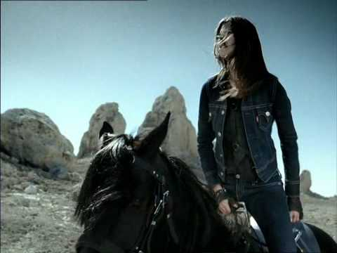 Levi's Jeans Commercial - Woman on horse jumping over a Train