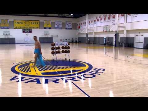 Stephen Curry bombing half-court shots