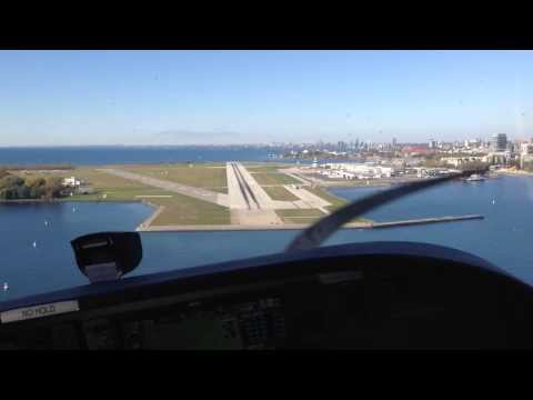 Approach and landing at Toronto's Billy Bishop City Centre Airport (YTZ). Beautiful city views!