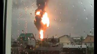 Massive oil tank explosion filmed from 2 km away