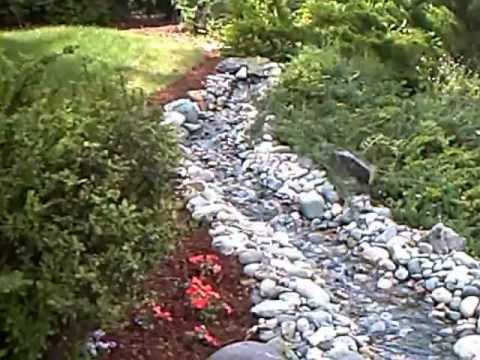 How to build a garden stream youtube for Building a backyard pond