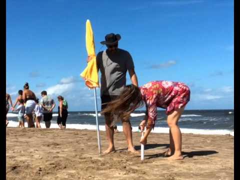 An EZ Sand Sucker anchors an umbrella on a windy beach in Argentina