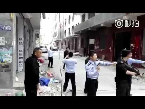 Rare footage: Chinese police gun down a man in C China with his family pleading aside