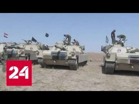 Яркие кадры: Колонна российской бронетехники вошла для