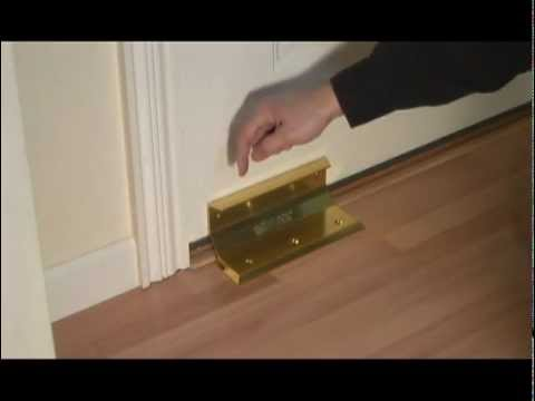 Door barricade nightlock home security door brace for Door knocking sound prank