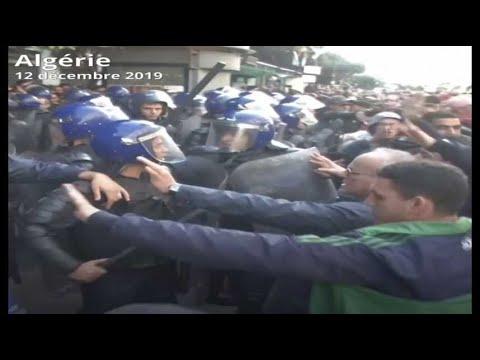 Présidentielle en Algérie: Vote brièvement suspendu et manifestations de masse à Alger