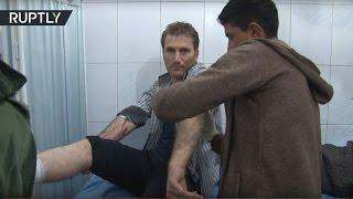 Пострадавшие при обстреле Алеппо поступают в местный госпиталь