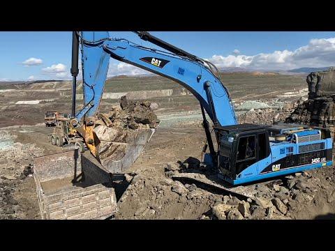 cat-345c-excavator-loading-trucks