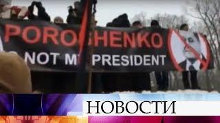 Сотни людей в центре Киева требуют отставки президента Украины.