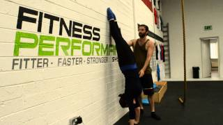 How to Balance a Handstand: Heel pulls