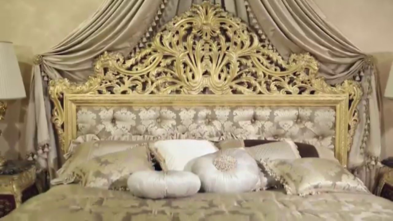 The luxury double bed emperador gold in fine carvings and soft