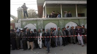 Millions vote in Afghanistan's long-delayed election