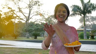 Happy young female in traditional wear enjoying and celebrating Holi festival, India
