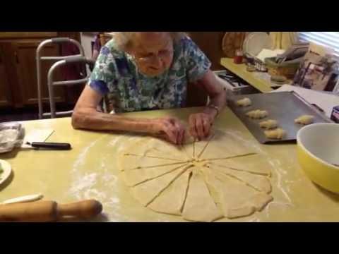Grandma making butter horn rolls