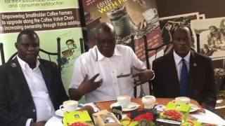 Hon. Gerald Ssendaula explaining the National Coffee Policy
