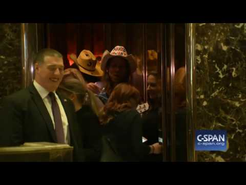Sen. Heidi Heitkamp gets into Trump Tower elevator with the Naked Cowboy