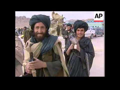 Afghan interim leader makes base in Mullah Omar's compound.