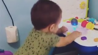 Baby hilariously dances along to toy music