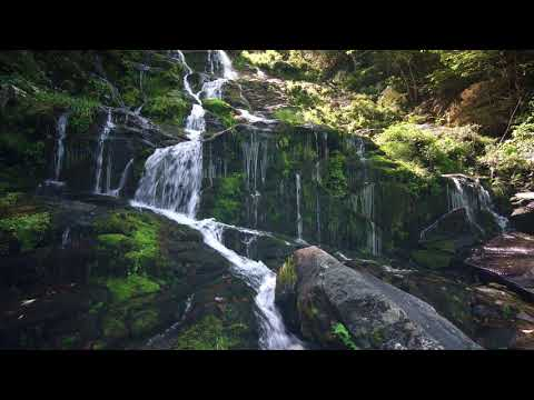 Small steps of waterfalls flowing down the mountains - 4k Video Seductive Nature