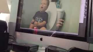 Here's 2 year old Aidan (who is potty training) watching video of a 2 year old Sean potty training!