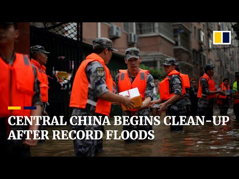 Central China begins clean-up after record floods but other other cities brace for typhoon
