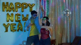 Happy Indian couple enjoying dancing at a New Year masquerade party - festive scene