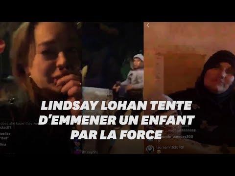 Dans une rue de Paris, Lindsay Lohan tente d'emmener l'enfant d'une famille qui dort dehors