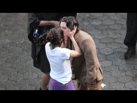 Selena Gomez & Timothée Chalamet Kissing In The Rain On Set Of Woody Allen's New Movie 9/26/2017 from YouTube · Duration:  52 seconds