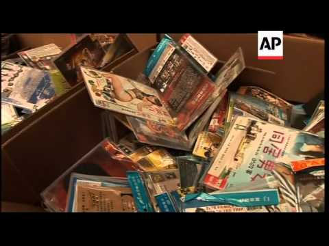 Officials destroy pirated DVDs in front of cameras