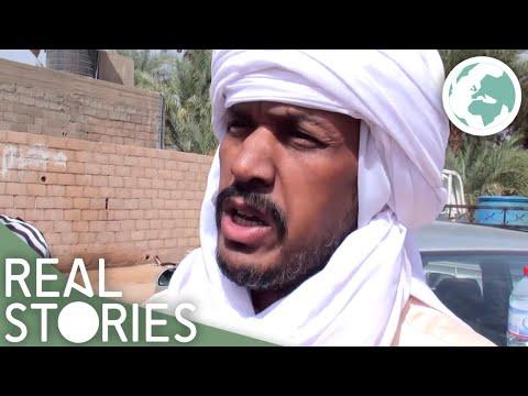 Along Gaddafi