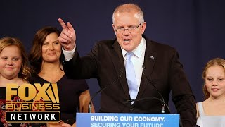 Australia's conservative coalition pulls off surprise election victory