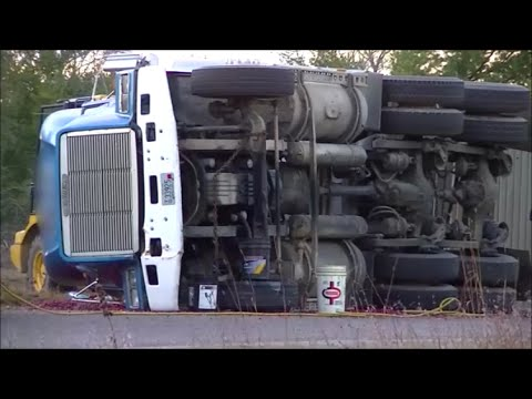 Semi Flipped on Side Tow Truck Recovery