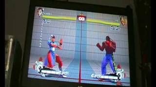 Super Street Fighter 4... how to do ultra and super combos.