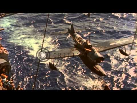 Cruiser USS Chester Recovers Her OS2U Kingfisher Floatplane, While Underway In Th...HD Stock Footage
