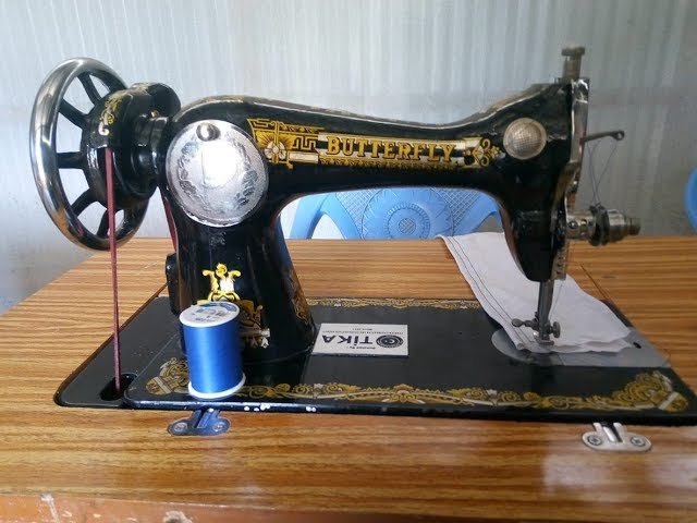Brother Joseph From GMFC/WFF Kibera Slum Testing Sewing Machine